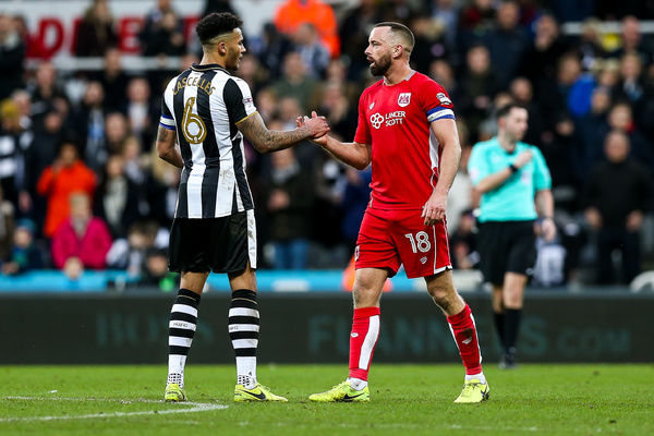 Jamaal Lascelles of Newcastle United and Aaron Wilbraham of Bristol City congratulate each other after the game ends 2-2 with City having led 0-2 at half time - Rogan Thomson/JMP - 25/02/2017 - FOOTBALL - St James' Park - Newcastle, England