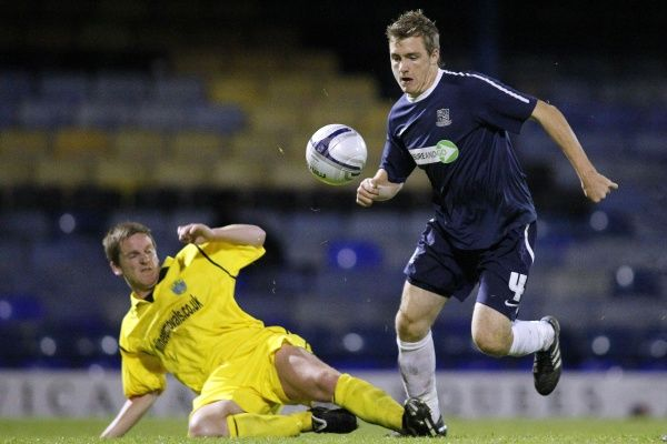 Jamie Stevens (Southend United) avoids Mark Doyle's (Barking) tackle - Southend United vs. Barking - Essex Senior Cup Third Round at Roots Hall, Southend - Mandatory Credit: Pixel8 Photos/David Scriven