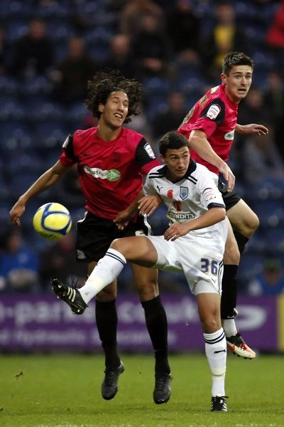 Luke Clark (Preston North End), Bilel Mohsni (Southend United) and Ryan Leonard (Southend United) all go for the ball - Preston North End vs. Southend United - FA Cup First Round with Budweiser at Deepdale, Preston - 12/11/11 - Mandatory Credit