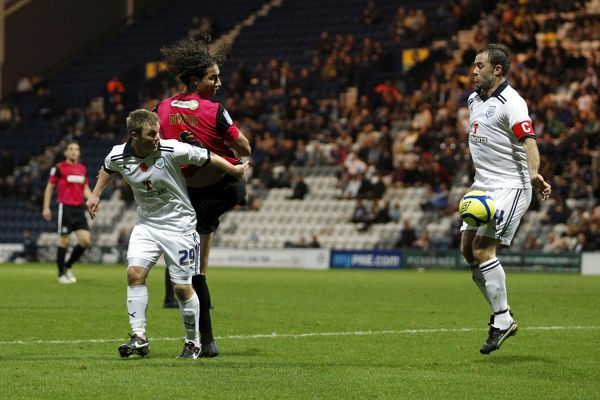 Ian Ashbee (Preston North End) blocks a Bilel Mohsni (Southend United) header - Preston North End vs