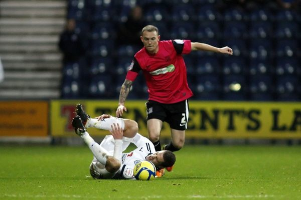 Paul Coutts (Preston North End) takes a tumble under pressure from Sean Clohessy (Southend United) - Preston North End vs