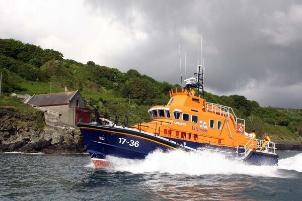Penlee Severn Class Lifeboat 17-36 Ivan Ellen sailing past the old Penlee boathouse at Mousehole