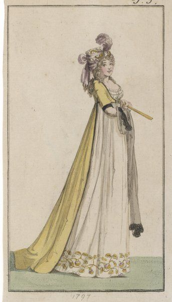 A lady wears a long high- waisted dress and a plumed hat, carrying a shawl and a fan