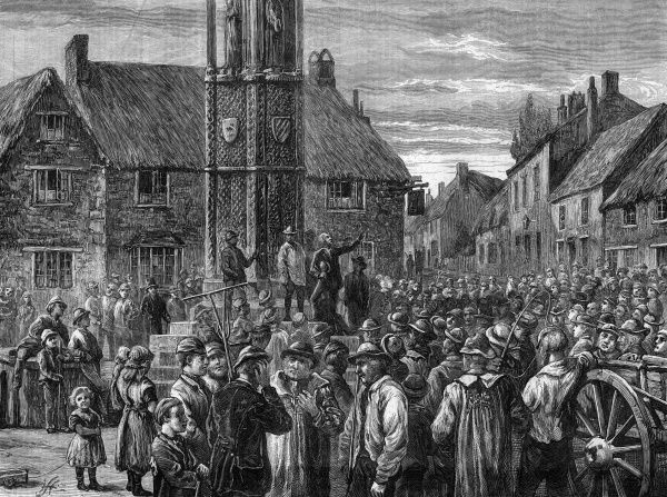 During the period of agricultural unrest, farm labourers meet at the Eleanor Cross in Geddington, Northamptonshire Date: 1872