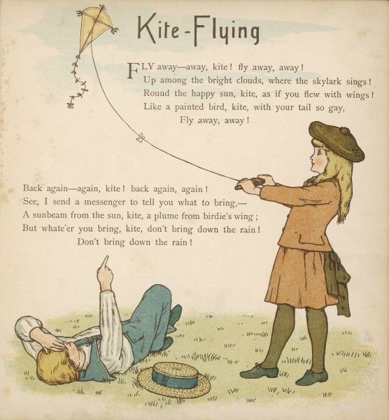 A boy lies on the grass while a girl flies a kite
