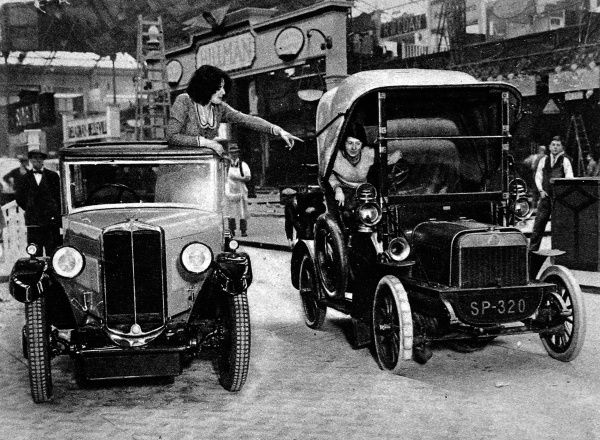 Photograph showing the 1905 Swift car beside a modern 8-h.p. 'Cadet' of the same make (both driven by women)