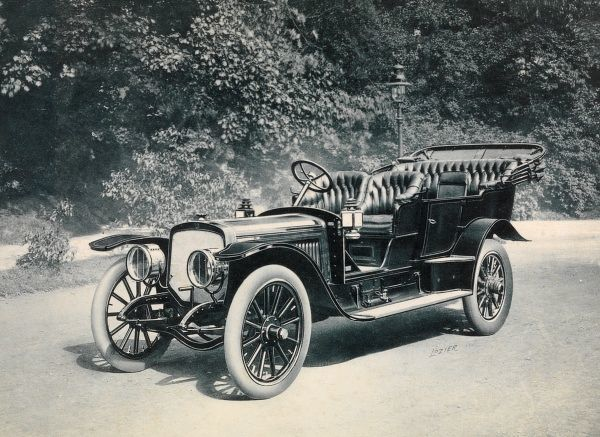 Autos, Old Styles. 1909 Lozier touring car parked outside on a road