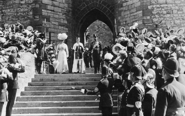 King George V and Queen Mary presenting their eldest son, Prince Edward to the crowds after his investiture as Prince of Wales at Caernarvon Castle on 13 July 1911