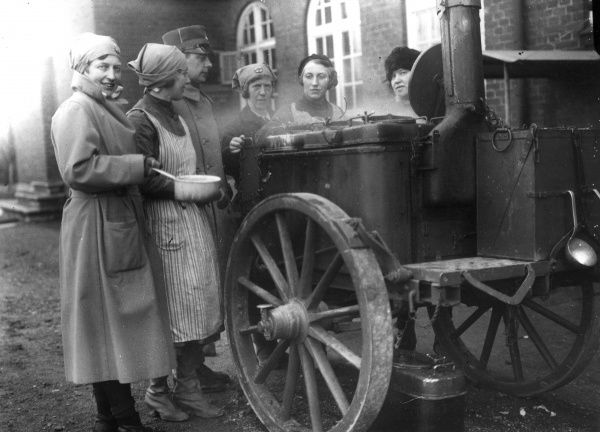 Womens's Army Auxiliary Corps cooking at a field-kitchen, 1933. Date: 1933