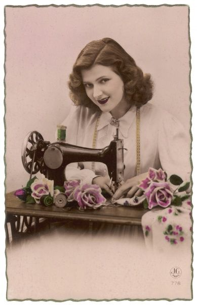 An elegant young woman, using her sewing machine