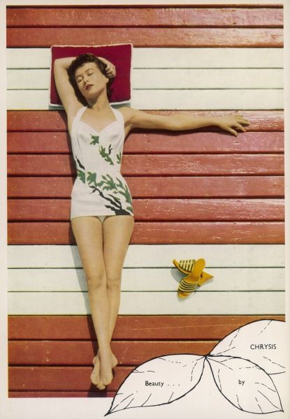 A woman stretches out luxuriantly in the sunshine wearing a swimsuit. Date: 1954