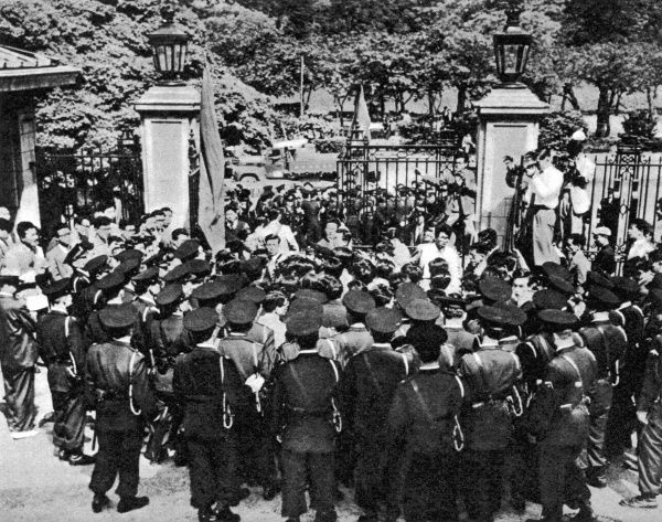 Tokyo, Japan: a small group of Japanese students, entirely surrounded by police, demonstrating against the British nuclear tests. On May 16th 1957 a group of members of the Tokyo Students' Union demostrated outside the gates of the British Embassy