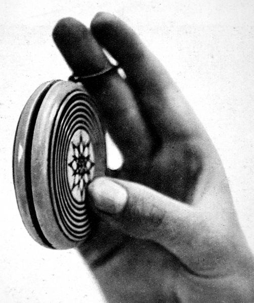 Photograph showing a yo-yo, made of ivory and brass during the Napoleonic period, in action in 1932
