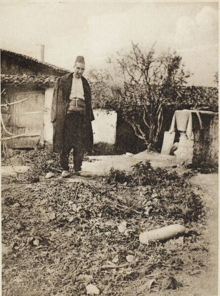 Macedonia - a Turkish Notable (Dignitary) in his garden looking at a Bulgarian shell which had not exploded