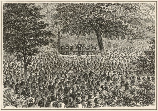 "The first Republican Convention Held ""Under the Oaks"" at Jackson, Michigan. A large crowd has gathered to hear the speakers who are raised up on a stage"