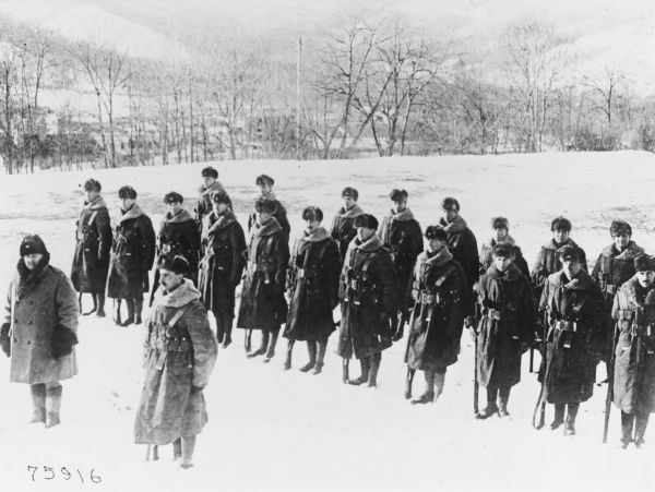 In Siberia, soldiers of the 9th (Cyclist) Battalion of the Hampshire Regiment instruct American officers in the British method of physical training