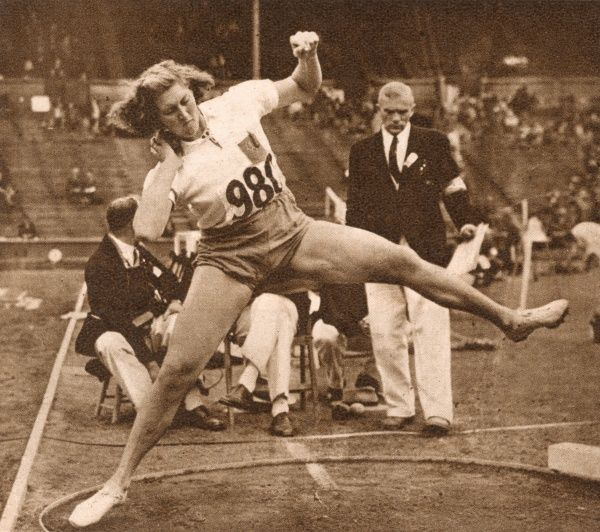 A. E. Panhorst-Niesink, a competitor from Holland, taking part in the qualifying rounds of the women's shot put. This event was included for the first time at the XIVth Olympiad in London. Date: 1948