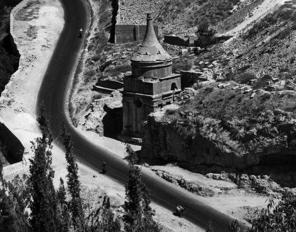 Absalom's Pillar and the road at the bottom of the Mount of Olives, Jerusalem, Israel. Date: 1960s