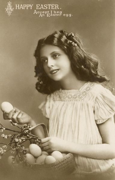 'Accept, I beg, an Easter egg' A pretty girl offering Easter eggs from a basket