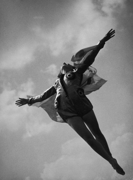 A young girl soars upwards dressed as a butterfly