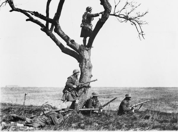 Gordons in support watching the fighting. They are halted in the open lining a low ridge at Nesle during the actions of the Somme Crossings on the Western Front in France during World War I in March 1918