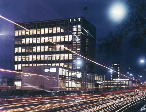 A wonderful advertising picture taken for International Computers and Tabulators, showing their office building and lines of light left by the passing traffic. Photograph by Heinz Zinram
