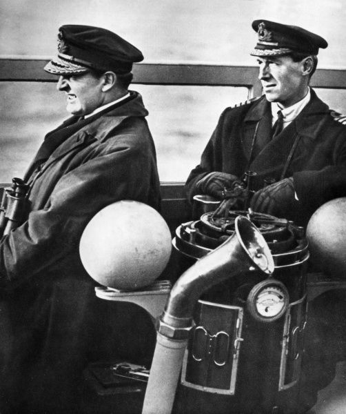Admiral of the Fleet Sir David Richard Beatty, 1st Earl Beatty (1871-1936) and Admiral of the Fleet Alfred Ernle Montacute Chatfield, 1st Baron Chatfield (1873-1967) (at the time Admiral and Flag-Captain respectively), watching the approach