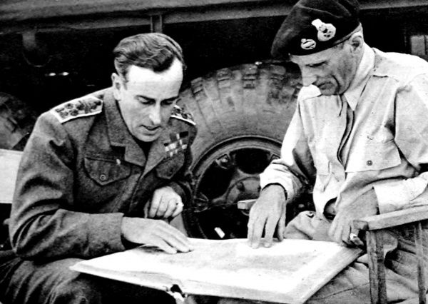 Photograph showing Admiral Lord Louis Mountbatten (1900-1979), then Commander-in-Chief of the South-East Asia Command, talking with General Montgomery (1887-1976) in Normandy, France, 1944