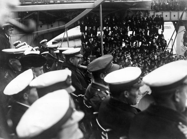 Admiral Sir Ernest Frederick Augustus Gaunt (1865-1940), Royal Naval officer, seen here with others watching a 4th Battle Squadron boxing match on board a ship (possibly HMS Benbow). Date: circa 1917