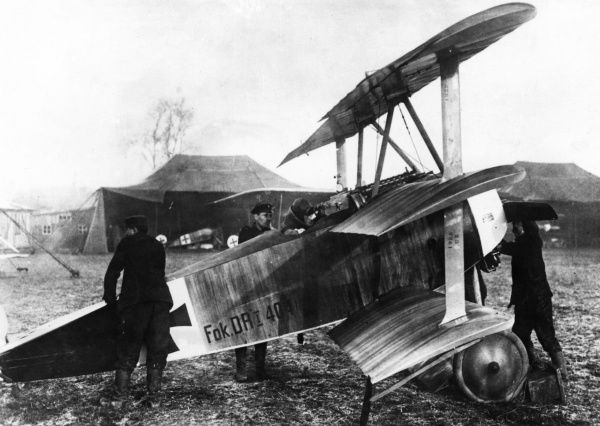 Hauptmann (Captain) Adolf Ritter von Tutschek (1891-1918), German soldier turned aviator, air ace (with 27 victories). Seen here in his Fokker triplane at Foulis near Laon, northern France, during the First World War. Date: March 1918