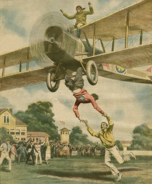 American acrobats exploit the aeroplane to perform such feats as being lifted off the ground by a partner suspended below the aircraft... and not even wearing a safety helmet!