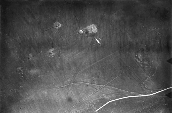 Aerial photograph (German) of La Grange en Haye, north eastern France, during the First World War, with a German plane visible below. Date: 13 November 1917