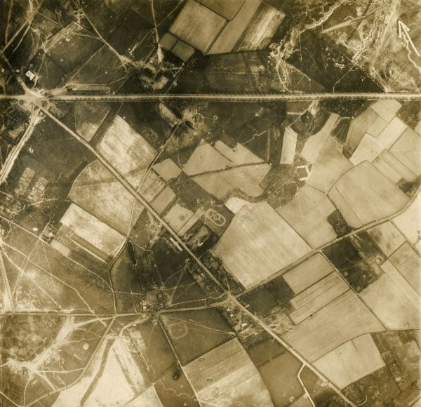 Aerial photograph (German) of a rural area on the western front during the First World War, showing fields, roads and buildings. Date: 12 May 1917