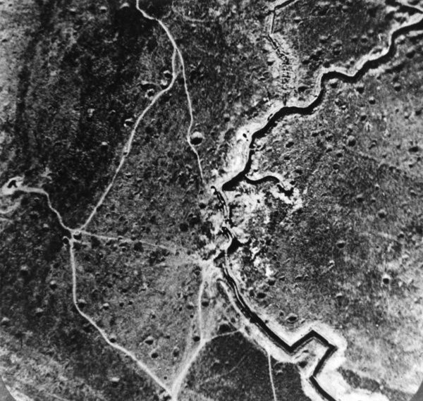Aerial photograph (British) of trenches, mine craters and shell pitted ground, somewhere on the western front during the First World War. Date: 1914-1918