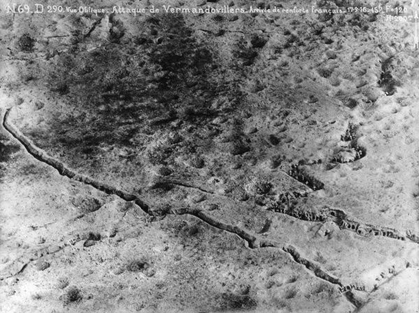 Aerial photograph (French) of a battlefield on the western front at Vermandovillers, northern France, during the First World War, just as French reinforcements were arriving -- men can be seen in the trenches. Date: 17 September 1916