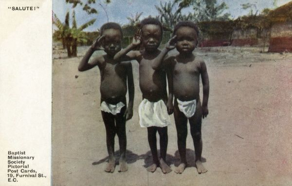 These three young Africans have been taught to dress respectably and to salute their elders and betters... Date: early 20th century