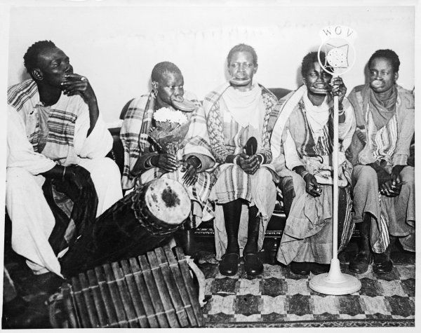 Congo natives with lip plates (pelele) making a radio broadcast in West Africa