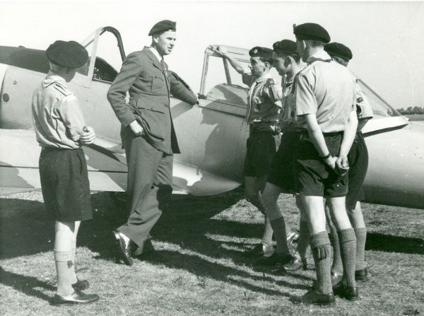 Headquarters Commissioner for Air Scouts talking with Air Scouts from Cheltenham with a de Havilland Chipmunk in the background. circa 1950s