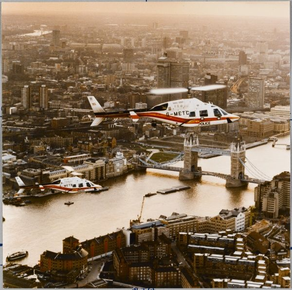 Two of the first three Metropolitan Police Bell 222 air support helicopters (G-METB & G-METC) fly over Central London passing Tower Bridge