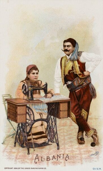 Albania - An Albanian woman (with her proud husband alongside) using a Singer Sewing Machine