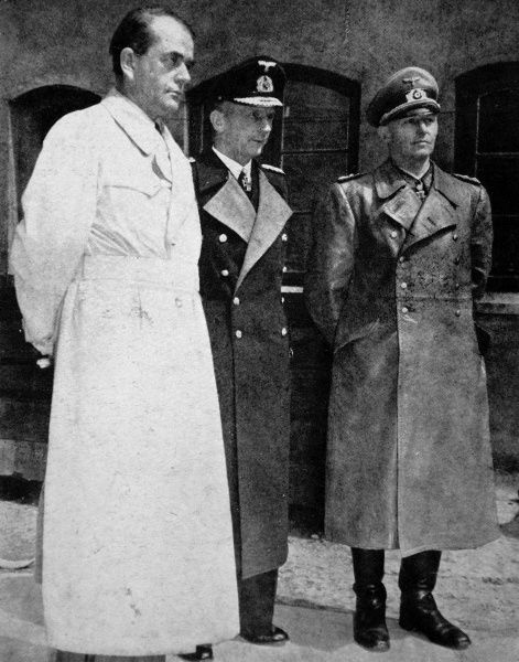Photograph showing Dr. Albert Speer (1905-1981), Grand-Admiral Karl Doenitz (1891-1980) and Colonel-General Alfred Jodl (1890-1946), at the end of the Second World War in Europe, May 1945