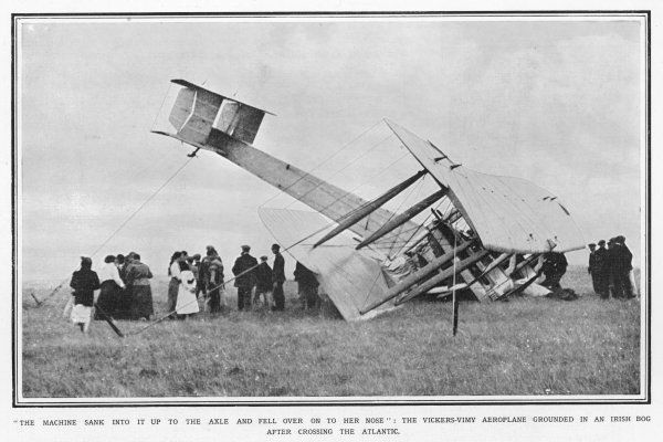 Captain Alcock and Lieutenant Brown terminate their successful first crossing of the Atlantic by air by crashing their Vickers 'Vimy' in an Irish bog