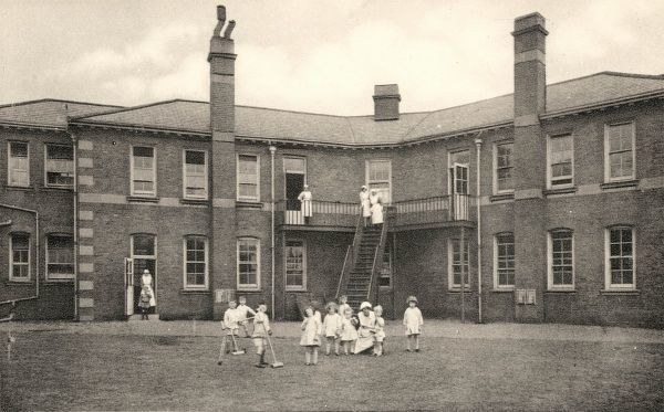 The Alexandra Orphanage on Maitland Park Road, Haverstock Hill, North London. Nursery children are at play while nurses keep watch