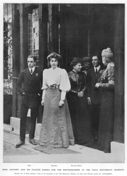 King Alfonso XIII of Spain poses with family and his bride-to-be, Princess Ena of Battenberg, daughter of Princess Beatrice at the Villa Mouriscot in Biarritz where the young king had courted and proposed to Ena. Date: 1906