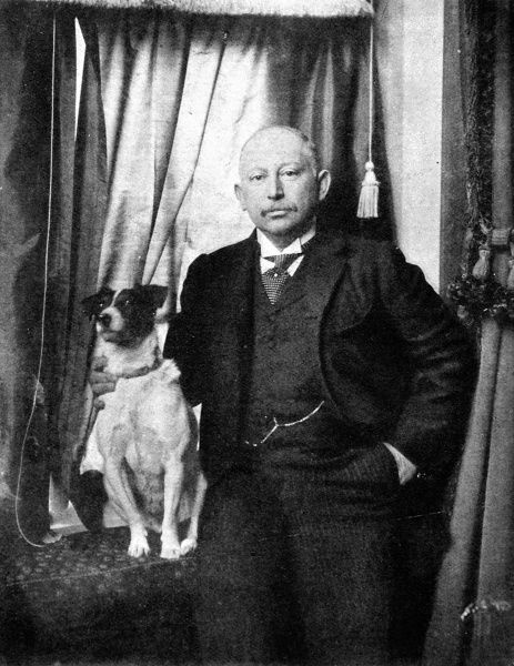 Photographic portrait of Alfred Beit, the British South African financier, pictured with his pet dog c.1906