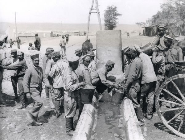 Allied soldiers (Russian, Italian and possibly French) collecting water from a well at Salonika (Salonica, Thessaloniki, Greece) during the First World War. Date: August 1916