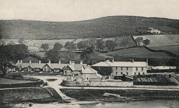 Rothbury almshouses (left of centre) and former Union workhouse (right of centre). The workhouse, on Town Foot, Rothbury, Northumberland, was closed in 1902 when a new building was opened elsewhere in the town