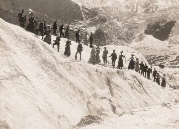 A climbing party pause to have their photo taken in the snow near Grindelwald, Switzerland
