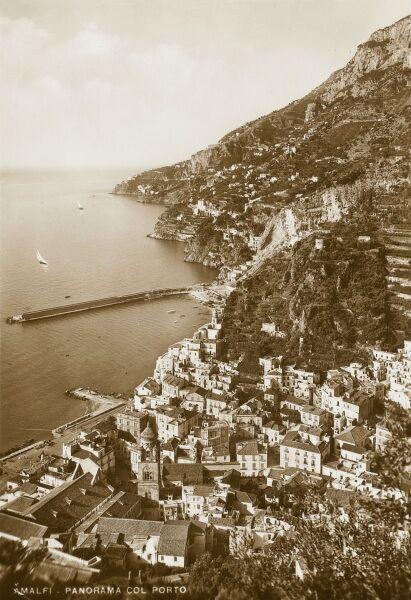 Stunning sepia shot of Amalfi, showing the layers of housing creeping up the hillside and down to the sea. Gardens and vinyards are cut into terraces on the slopes