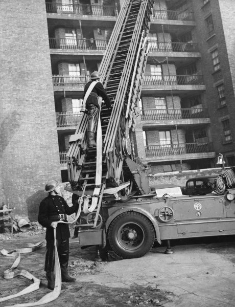 American soldiers on duty with the London Fire Brigade practice British Fire Fighting techniques including climbing up steel turn table ladder. They can then use these skills when they return to civilian life in the United States